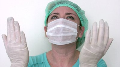 stock-footage-doctor-praying-for-her-critical-surgery